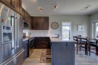 Photo 3: 1001 Jumping Pound Common in Cochrane: House for sale : MLS®# c4248929