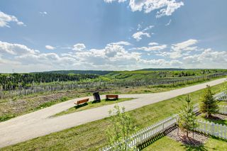 Photo 2: 1001 Jumping Pound Common in Cochrane: House for sale : MLS®# c4248929