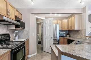 Photo 5: 26 BRIDLECREST Road SW in Calgary: Bridlewood Detached for sale : MLS®# C4302285