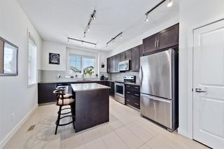 Photo 13: 547 SHERWOOD Boulevard NW in Calgary: Sherwood Row/Townhouse for sale : MLS®# A1018882