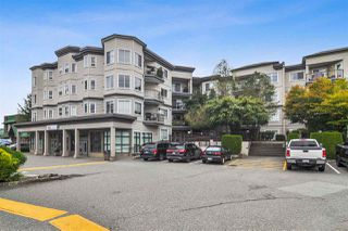 """Photo 1: 317 5759 GLOVER Road in Langley: Langley City Condo for sale in """"College Court"""" : MLS®# R2493395"""