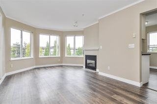 """Photo 2: 317 5759 GLOVER Road in Langley: Langley City Condo for sale in """"College Court"""" : MLS®# R2493395"""