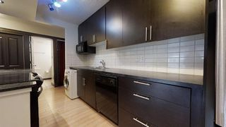 Photo 5: 405 501 57 Avenue SW in Calgary: Windsor Park Apartment for sale : MLS®# A1052996