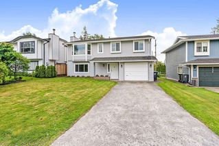 Photo 1: 9544 214A Street in Langley: Walnut Grove House for sale : MLS®# R2456131