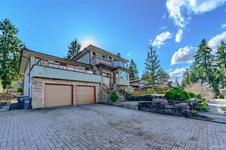 Photo 1: 610 WATERLOO Drive in Port Moody: College Park PM House for sale : MLS®# R2441481