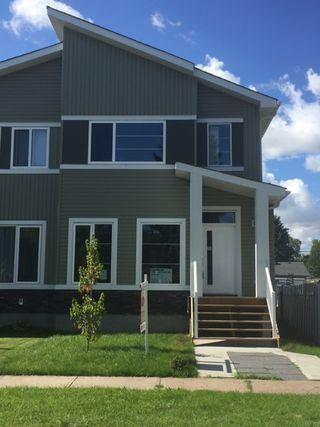 Main Photo: 12904 123 Street in Edmonton: Zone 01 House Half Duplex for sale : MLS®# E4172904