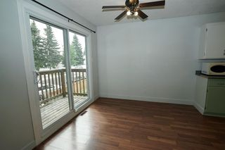Photo 5: 11427A 8 Street SW in Calgary: Southwood Row/Townhouse for sale : MLS®# A1035689