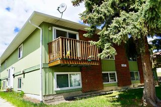 Photo 2: 11427A 8 Street SW in Calgary: Southwood Row/Townhouse for sale : MLS®# A1035689