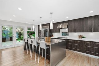 Photo 1: 2245 W 14TH Avenue in Vancouver: Kitsilano House 1/2 Duplex for sale (Vancouver West)  : MLS®# R2508108