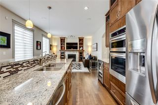 Photo 13: 66 ASPENSHIRE Place SW in Calgary: Aspen Woods Detached for sale : MLS®# C4303344