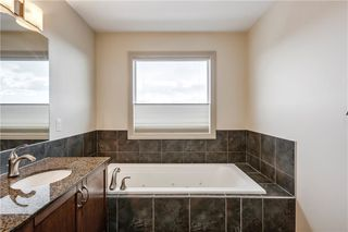 Photo 22: 66 ASPENSHIRE Place SW in Calgary: Aspen Woods Detached for sale : MLS®# C4303344