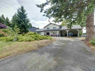 Photo 1: 6447 SAMRON Road in Sechelt: Sechelt District House for sale (Sunshine Coast)  : MLS®# R2473484