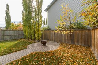 Photo 24: 69 Cougarstone Villas SW in Calgary: Cougar Ridge Detached for sale : MLS®# A1039696