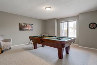 Photo 19: 69 Cougarstone Villas SW in Calgary: Cougar Ridge Detached for sale : MLS®# A1039696