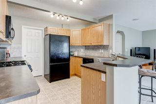 Photo 9: 69 Cougarstone Villas SW in Calgary: Cougar Ridge Detached for sale : MLS®# A1039696