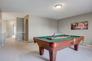 Photo 20: 69 Cougarstone Villas SW in Calgary: Cougar Ridge Detached for sale : MLS®# A1039696