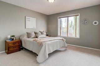 Photo 12: 69 Cougarstone Villas SW in Calgary: Cougar Ridge Detached for sale : MLS®# A1039696
