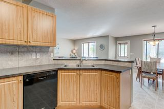 Photo 10: 69 Cougarstone Villas SW in Calgary: Cougar Ridge Detached for sale : MLS®# A1039696
