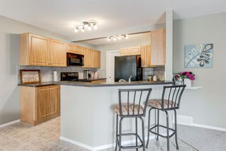 Photo 8: 69 Cougarstone Villas SW in Calgary: Cougar Ridge Detached for sale : MLS®# A1039696