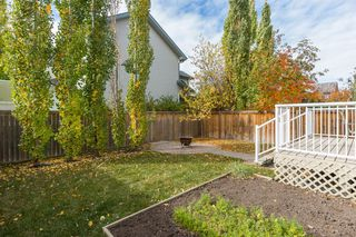 Photo 23: 69 Cougarstone Villas SW in Calgary: Cougar Ridge Detached for sale : MLS®# A1039696