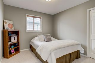 Photo 14: 69 Cougarstone Villas SW in Calgary: Cougar Ridge Detached for sale : MLS®# A1039696