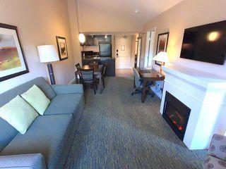 """Photo 5: 210 40900 TANTALUS Road in Squamish: Tantalus Condo for sale in """"Executive Suites Hotel"""" : MLS®# R2442400"""
