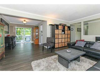 Photo 2: 818 ESSEX Avenue in Port Coquitlam: Lincoln Park PQ House for sale : MLS®# R2478115