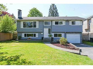 Photo 1: 818 ESSEX Avenue in Port Coquitlam: Lincoln Park PQ House for sale : MLS®# R2478115
