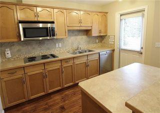 Photo 8: 19 EVERRIDGE Villa SW in Calgary: Evergreen Semi Detached for sale : MLS®# C4297009