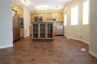 Photo 7: 19 EVERRIDGE Villa SW in Calgary: Evergreen Semi Detached for sale : MLS®# C4297009