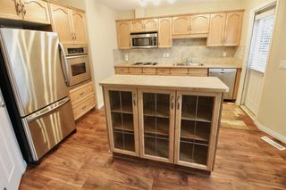 Photo 5: 19 EVERRIDGE Villa SW in Calgary: Evergreen Semi Detached for sale : MLS®# C4297009