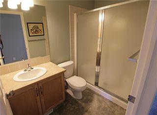 Photo 31: 19 EVERRIDGE Villa SW in Calgary: Evergreen Semi Detached for sale : MLS®# C4297009