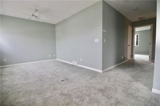 Photo 20: 19 EVERRIDGE Villa SW in Calgary: Evergreen Semi Detached for sale : MLS®# C4297009