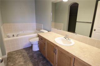 Photo 24: 19 EVERRIDGE Villa SW in Calgary: Evergreen Semi Detached for sale : MLS®# C4297009