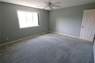 Photo 23: 19 EVERRIDGE Villa SW in Calgary: Evergreen Semi Detached for sale : MLS®# C4297009