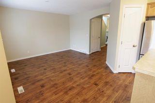 Photo 15: 19 EVERRIDGE Villa SW in Calgary: Evergreen Semi Detached for sale : MLS®# C4297009