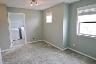 Photo 19: 19 EVERRIDGE Villa SW in Calgary: Evergreen Semi Detached for sale : MLS®# C4297009
