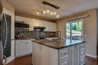 Photo 12: 925 ARBOUR LAKE Road NW in Calgary: Arbour Lake Detached for sale : MLS®# A1031863