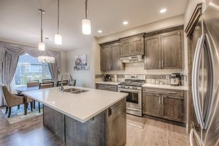 Photo 3: 36 EVANSGLEN Close NW in Calgary: Evanston Semi Detached for sale : MLS®# A1037291
