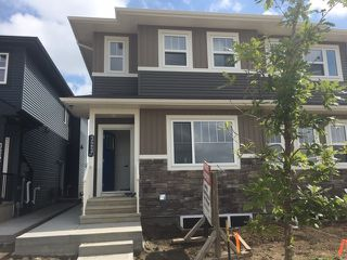 Photo 1: 323 Orchards Boulevard in Edmonton: Zone 53 House Half Duplex for sale : MLS®# E4168128