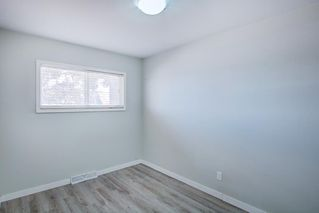 Photo 18: 7743 FLEETWOOD Drive SE in Calgary: Fairview Detached for sale : MLS®# A1009160