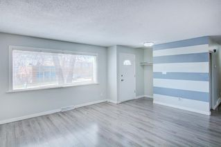 Photo 3: 7743 FLEETWOOD Drive SE in Calgary: Fairview Detached for sale : MLS®# A1009160