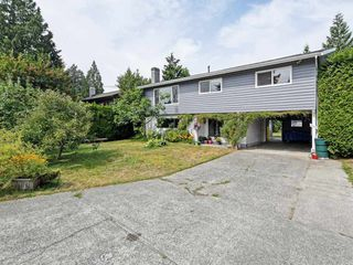 Photo 1: 2111 CENTENNIAL Avenue in Port Coquitlam: Glenwood PQ House for sale : MLS®# R2399551