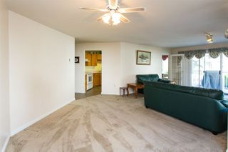 """Photo 6: 114 5375 205 Street in Langley: Langley City Condo for sale in """"Glenmont Park"""" : MLS®# R2461210"""