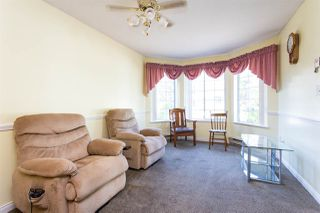 """Photo 11: 114 5375 205 Street in Langley: Langley City Condo for sale in """"Glenmont Park"""" : MLS®# R2461210"""