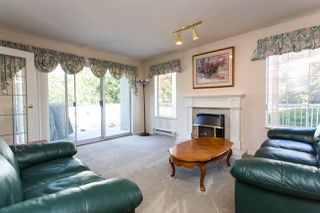 """Photo 2: 114 5375 205 Street in Langley: Langley City Condo for sale in """"Glenmont Park"""" : MLS®# R2461210"""