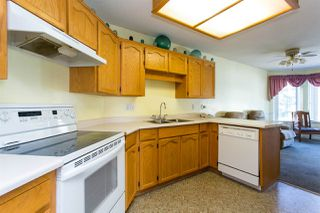 """Photo 9: 114 5375 205 Street in Langley: Langley City Condo for sale in """"Glenmont Park"""" : MLS®# R2461210"""