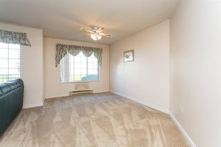 """Photo 7: 114 5375 205 Street in Langley: Langley City Condo for sale in """"Glenmont Park"""" : MLS®# R2461210"""
