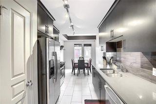 Photo 11: 313 AUBURN BAY Square SE in Calgary: Auburn Bay Row/Townhouse for sale : MLS®# C4302662