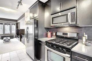 Photo 12: 313 AUBURN BAY Square SE in Calgary: Auburn Bay Row/Townhouse for sale : MLS®# C4302662